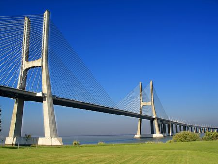 Bridge with green grass and blue sky       Stock Photo
