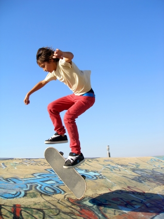 Big skate park showing a boy skating photo
