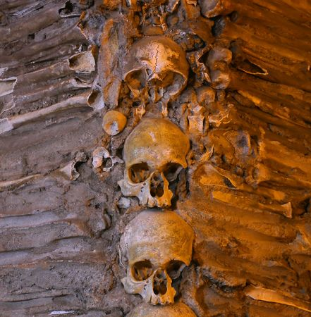 Lots of stacked human bones and skulls Stock Photo