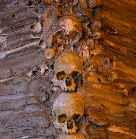 human bones: Lots of stacked human bones and skulls Stock Photo