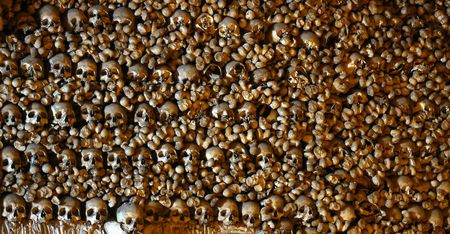 genocide: Lots of stacked human bones and skulls Stock Photo