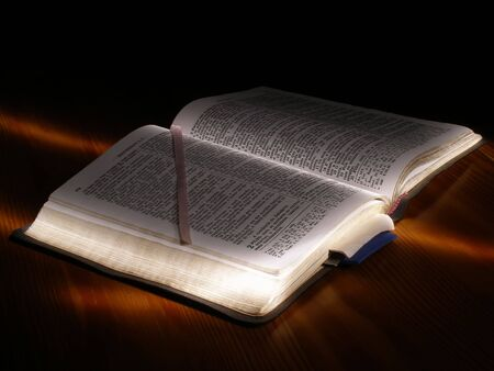 bible book: A Bible book opened on a wooden table Stock Photo