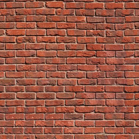 Seamless tile pattern of a clay brickwall. You can create an arbitrary image size by simply concatenating several of these images together. Each edge of this image matches with the opposite edge. Stock Photo