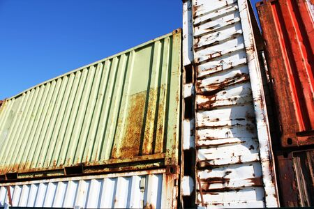 Old damaged and large containers
