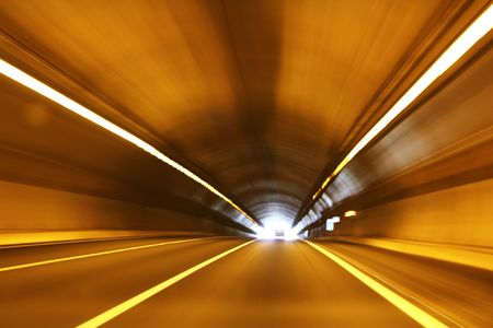 High speed tunnel. Exiting a tunnel at high speed. Stock Photo