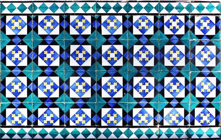 A beautiful ceramic tile pattern in blue, yellow and white photo