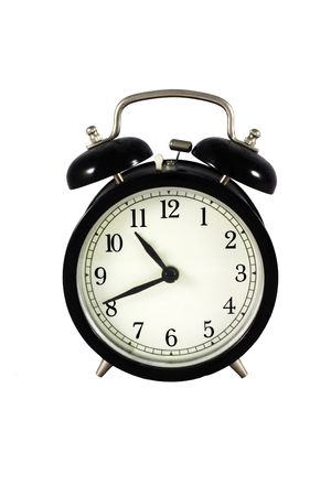 alarm clock: Black old alarm clock - isolated in white background