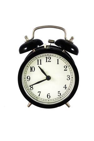 despertador: Negro viejo alarm clock - aislado en fondo blanco Foto de archivo