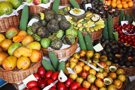 anona: Colorful fruit stand in a local market Stock Photo