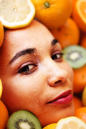 Beautiful woman face framed with oranges and lemons