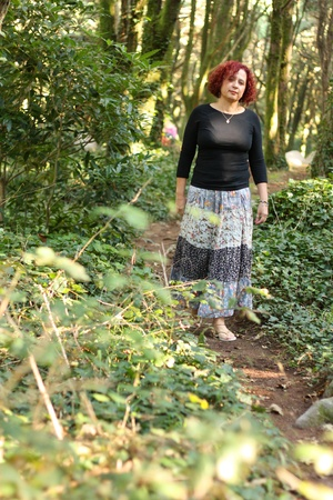 Red hair woman standing outdoors in a beautiful green forest Stock Photo - 8520417