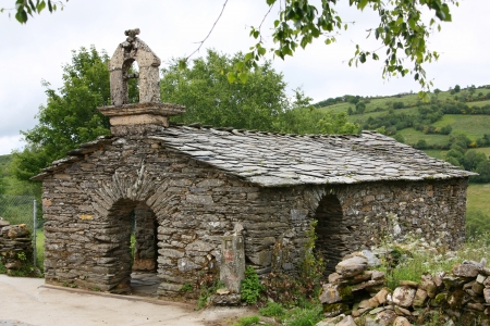 small chapel built with traditional stone at o camino de santiago photo