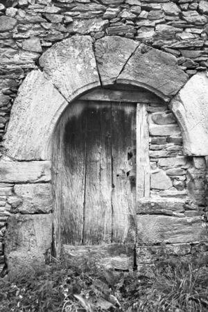 old door in black and white photo