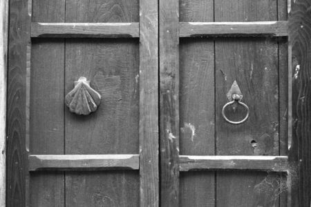 black   white door detail with a shell and handle Stock Photo