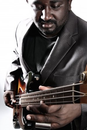 an american african bass player on white background photo
