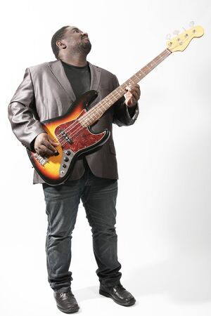 bass guitar: an american african bass player on white background