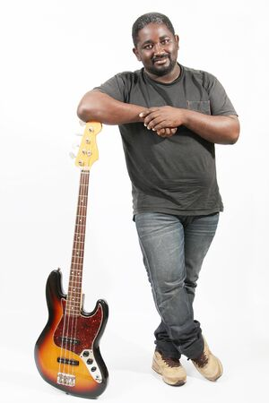 musical band: an american african bass player on white background