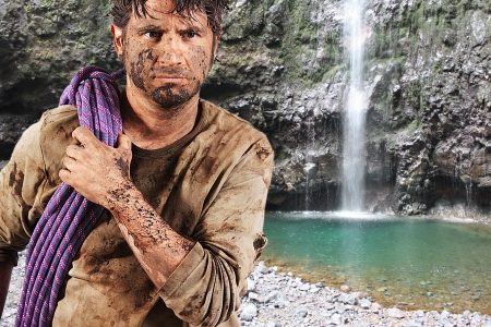 A man covered in mud with a rope, trying to survive Stock Photo - 16640840