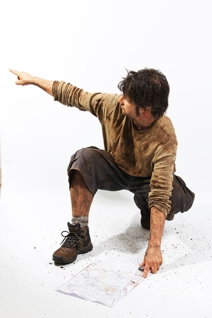 A man covered in mud with a rope, trying to survive Stock Photo - 16640838
