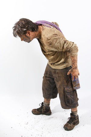 A man covered in mud with a rope, trying to survive Stock Photo - 16692266