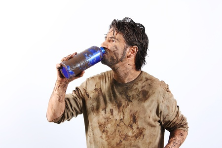A man covered in mud trying to survive Stock Photo - 16692261