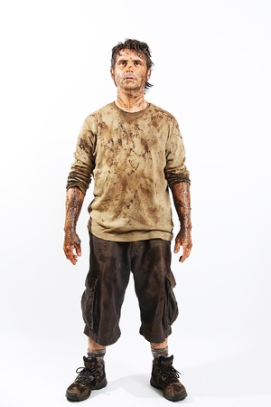 A man covered in mud trying to survive Stock Photo - 16692259