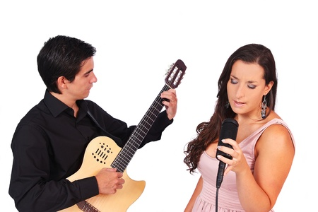 A female singer and a male guitarist laying down in white background photo