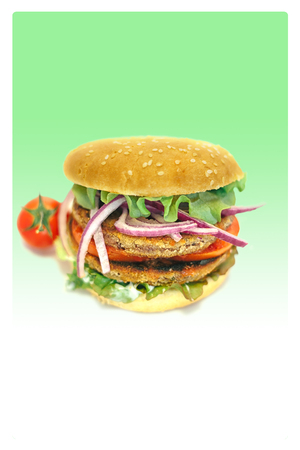 vegetarian hamburger: vegetarian hamburger with lettuce, tomato, onion and bun in green background