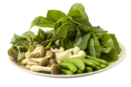 chinese spinach: Japanese shimeji mushroom, Spring peas and Chinese spinach display in a white plate ready to cook