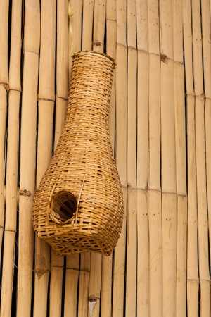 Bamboo eel trap norther Thai style hanging on bamboo wall photo