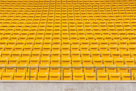 ringside: Yellow seats in the stadium prepare for watching and cheer sports