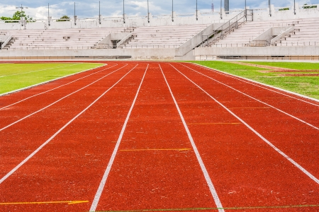 contend: Blank orange track in the stadium  runway  on the side of football field Stock Photo