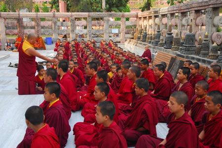 gaya: Bodh Gaya, India - April 5, 2013 - Unidentified young Buddhist monks parying at the Maha Bodhi Temple
