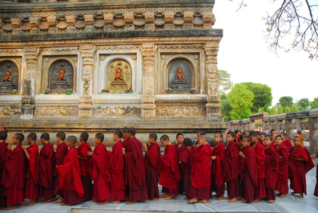 gaya: Bodh Gaya, India - April 5, 2013 - Unidentified young Buddhist monks standing at the Maha Bodhi temple complex Editorial