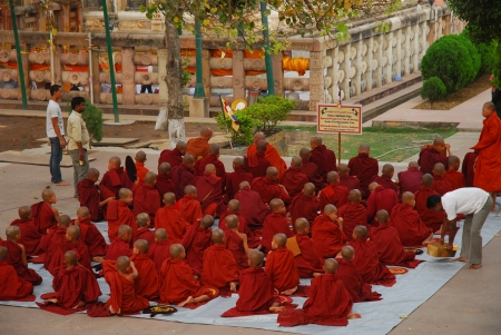 gaya: Bodh Gaya, India - April 5, 2013 - Unidentified young Buddhist monks praying at the Maha Bodhi temple complex