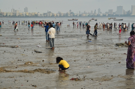 immersion: Mumbai, India - September 19, 2013 - Unidentified crowds at Chaupati Beach after the immersion of Lord Ganesha