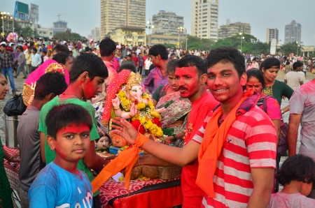 immersion: Mumbai, India - September 2013 - Devotees bringing Hindu God Ganesha into the ocean for immersion Editorial