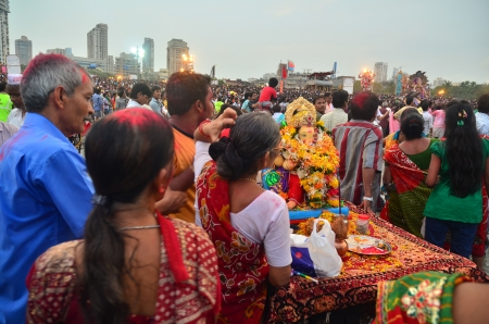 immersion: Mumbai, India - September 2013 - Devotees bringing Hindu God Ganesha to the ocean for immersion