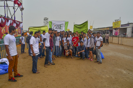 immersion: Mumbai, India - September 2013 - Volunteers helping to clean up the beach during the rain after the immersion of Hindu God Ganesha  Editorial