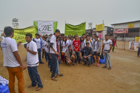 Mumbai, India - September 2013 - Volunteers helping to clean up the beach after the immersion of Hindu God Ganesha
