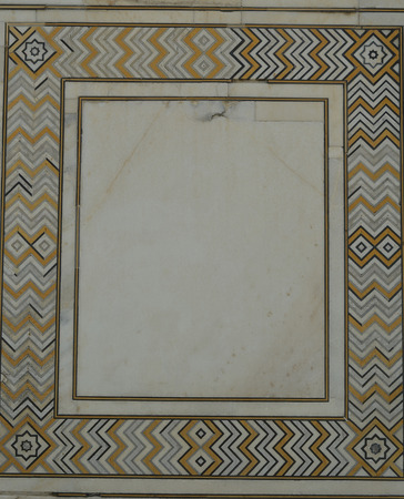 White Marble Wall of Taj Mahal, India with intricate designs and patterns with inlaid semi-precious stones  photo
