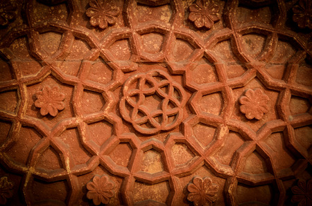 Decorative sandstone wall of Agra Fort India photo