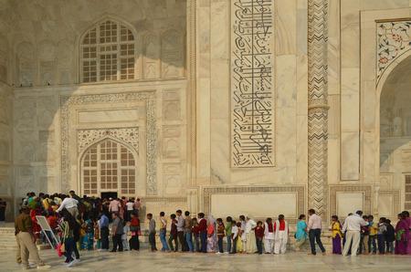 queueing: Agra, India - November 2013 - People queueing up to visit Taj Mahal