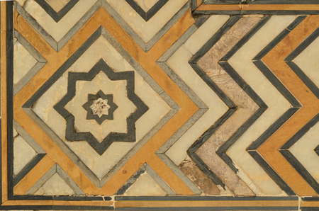 inlaid: White Marble Wall of Taj Mahal, India with intricate designs and patterns with inlaid semi-precious stones