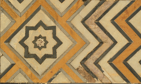 dura: White Marble Wall of Taj Mahal, India with intricate designs and patterns with inlaid semi-precious stones