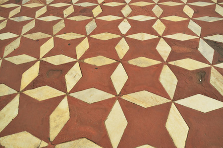 White Marble floorl of Taj Mahal with intricate designs and patterns with inlaid semi-precious stones