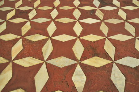 inlaid: White Marble floorl of Taj Mahal with intricate designs and patterns with inlaid semi-precious stones  Editorial