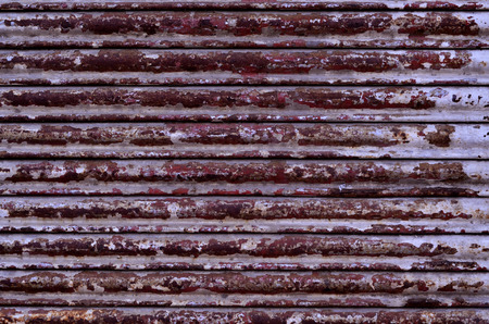 Corrugated Metal Sheet texture, background in red brown color photo