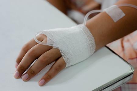 saline intravenous drip on children hand in hospital