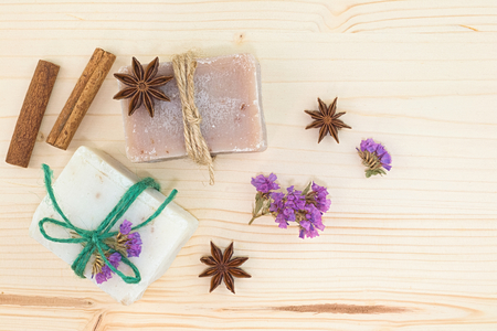 beautiful rare: Organic handmade soaps decoration by spices cinnamon, star anise and dry flowers on wood board with copy space